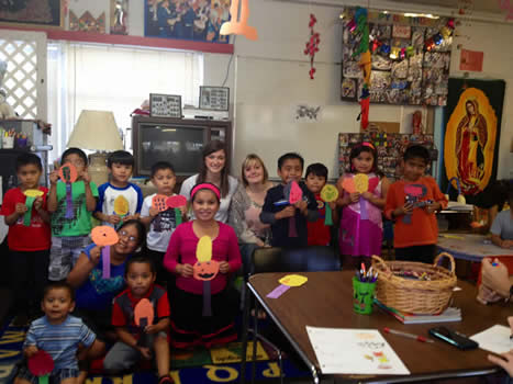 Students participate at the bilingual story hour with Hispanic children at La Casa Amiga