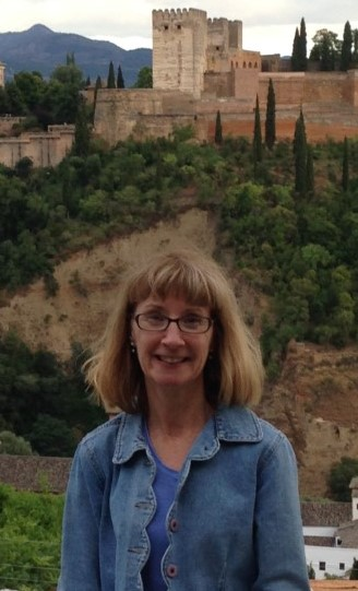 Spanish Professor Celia Dollmeyer at the Mirador de San Nicolas overlooking the Alhambra in Granada Spain